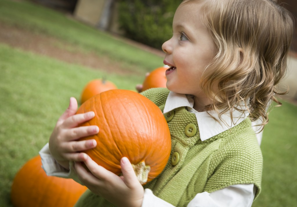 child and pumpkin