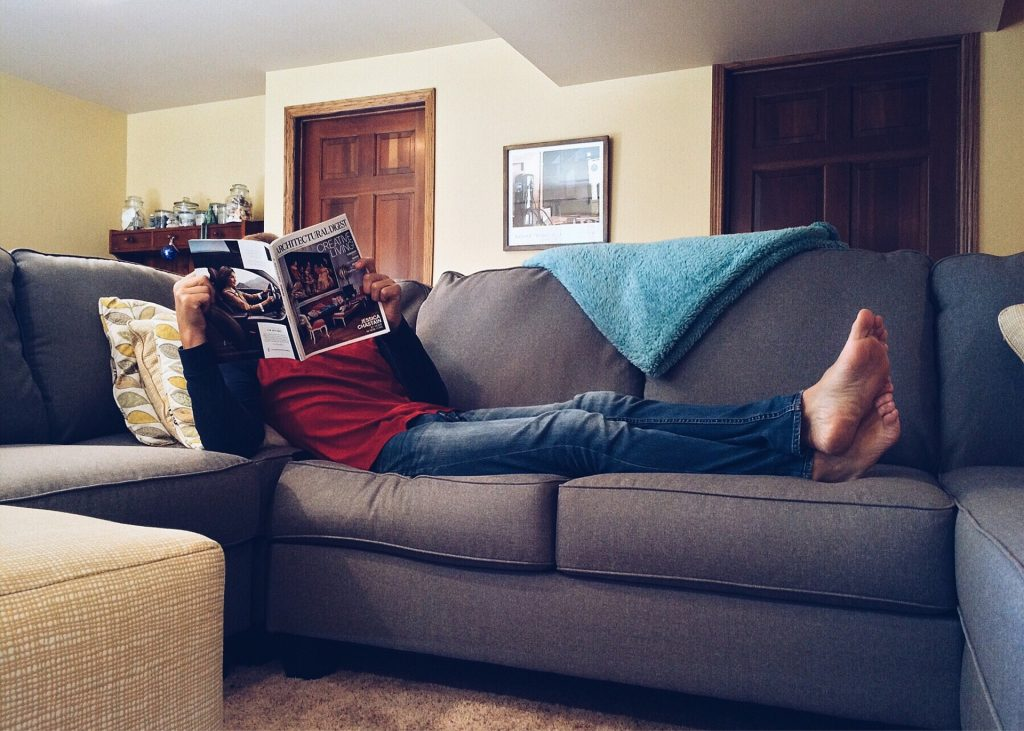 reading on sofa